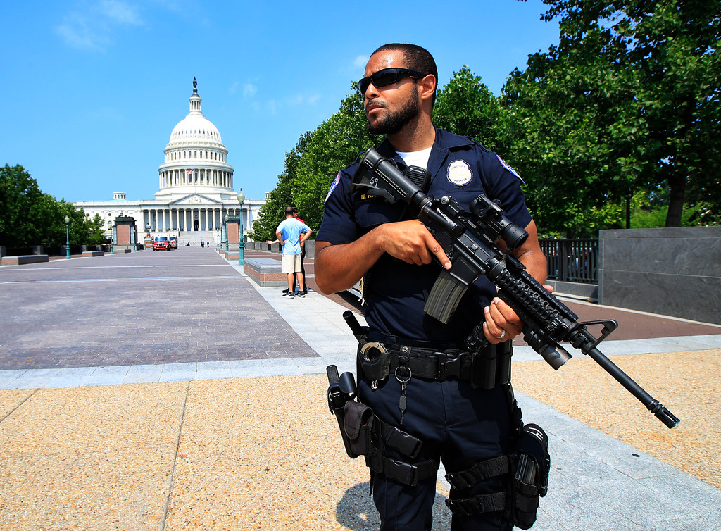 . Capitol Hill Police officer Nathan Rainey stands guard on Capitol Hill in Washington, Wednesday, June 14, 2017, after House Majority Whip Steve Scalise of La. was shot during a congressional baseball practice in Alexandria, Va. (AP Photo/Manuel Balce Ceneta)