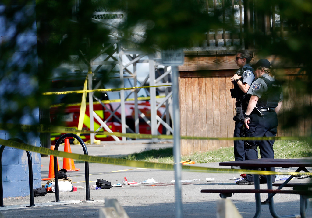 . Law enforcement officers stand at the scene of a shooting near a baseball field in Alexandria, Va., Wednesday, June 14, 2017, where House Majority Whip Steve Scalise of La. was shot during a congressional baseball practice. (AP Photo/Alex Brandon)