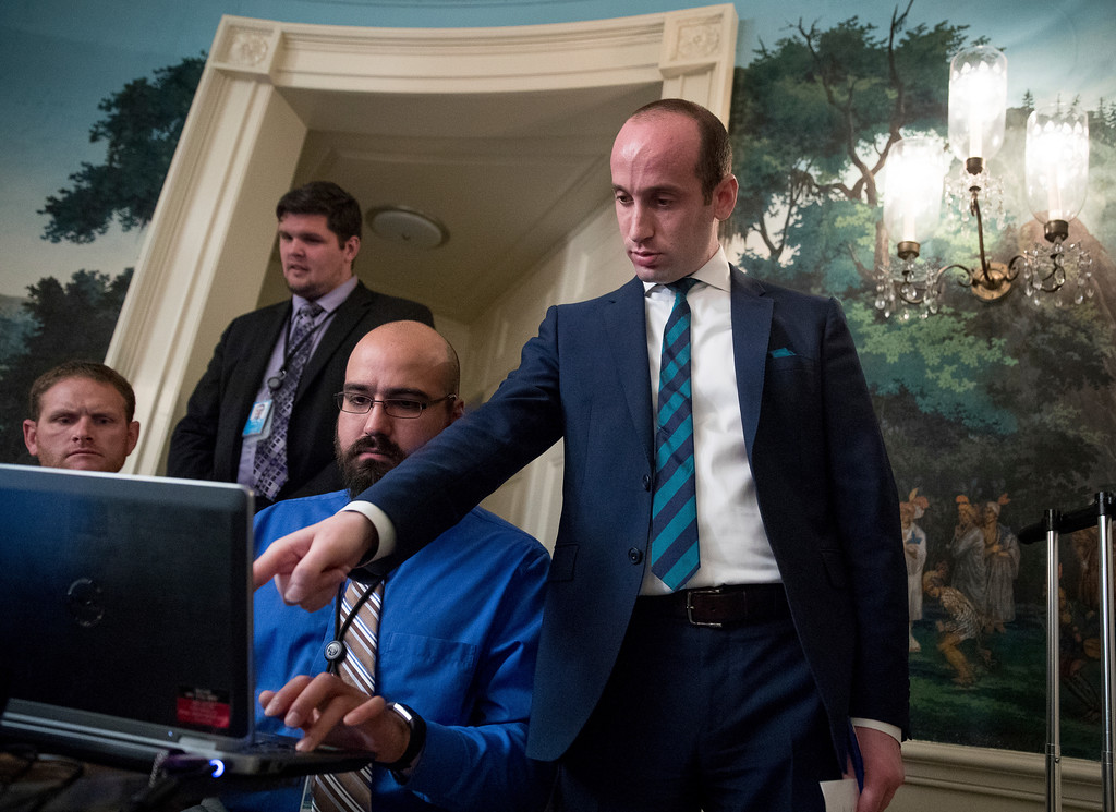 . President Donald Trump\'s White House Senior Adviser Stephen Miller works with staff before President Donald Trump arrives in the Diplomatic Room of the White House in Washington, Wednesday, June 14, 2017, to talk about the shooting in Alexandria, Va. where House Majority Whip Steve Scalise of La., and others, where shot during a Congressional baseball practice. (AP Photo/Andrew Harnik)