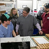 Congresswoman Lori Trahan was given a tour of Revolutionary Clinics' Fitchburg cultivation facility to see and discuss the role the emerging cannabis industry has played in economic revitalization efforts in Fitchburg, as well as future opportunities in Central and Western Massachusetts cities and towns that once were hubs of shoe and textile manufacturing and have since struggled to repurpose those buildings with job producing employers. Mayor Stephen DiNatale chats with Dustin Aldrich-Hunt in the extraction room about his work during the tour. On the right is Dan Gillan the Vice President of Product. SENTINEL & ENTERPRISE/JOHN LOVE