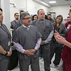 Congresswoman Lori Trahan was given a tour of Revolutionary Clinics' Fitchburg cultivation facility to see and discuss the role the emerging cannabis industry has played in economic revitalization efforts in Fitchburg, as well as future opportunities in Central and Western Massachusetts cities and towns that once were hubs of shoe and textile manufacturing and have since struggled to repurpose those buildings with job producing employers. Mayor Stephen DiNatale and Commissioner of the Cannabis Control Commission Jennifer Flanagan listens to Co-founder Ryan Ansin in the kitchen at the facility. Next to DiNatale is CEO Keith Cooper. SENTINEL & ENTERPRISE/JOHN LOVE
