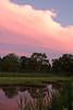 Sun setting over a salt water marsh