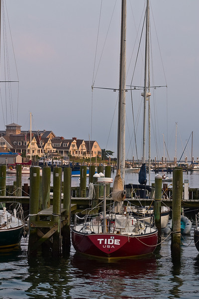 A docked sailboat frames some of the modern waterfront homes in the village'