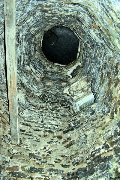 **Looking up into the tower**  After Kate's retirement, in 1879 a new wood framed Keeper's house was built to replace the old dilapidated 1823 structure.  The new Keeper, Leonard Clark, was a Civil War veteran who remained in his post for 28 years while raising three children with his wife.  Clark served until his death in 1906.