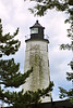 The Assembly purchased land on the western side of the harbor from Nathaniel Shaw who served as the first Keeper.  A 64 foot stone tower with a wooden lantern was completed and lit for the first time on November 7, 1761.