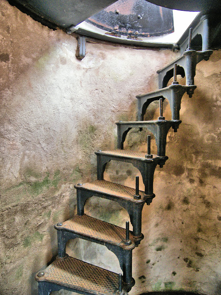 A wooden spiral staircase led to an iron lantern.