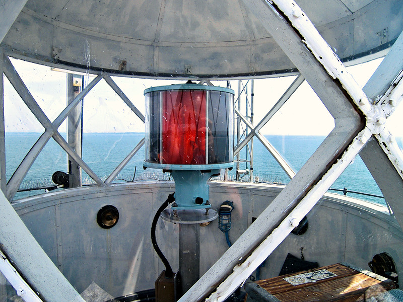 The lighthouse went into service on November 10, 1909.  A Fourth Order Fresnel lens from Henry-Lepaute of Paris used a flash pattern of 3 white flashes followed by a red flash every 30 seconds.  The lens was rotated by a gear system utilizing an 85 pound weight dropping down a central shaft to the basement.  The clockwork required winding once every 4 hours.
