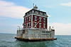 The lighthouse structure built on the pier was a 32 foot square, 3 floor brick and granite dwelling with a mansard roof and a cylindrical lantern room in the middle of the roof.  The dwelling incorporates Colonial Revival and French Second Empire styles due to the influence of wealthy homeowners in the area.