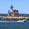 Penfield Reef Lighthouse is said to be haunted by the ghost of former Keeper Frederick A. Jordan.  On December 22, 1916 Jordan launched the station dory in rough seas to head for the mainland to spend Christmas with his family.  About 150 yards from the light, his boat capsized throwing Jordan into the water.  Jordan held onto the overturned boat while his Assistant Rudolph Iten watched from the tower.  The weather delayed Iten from heading after Jordan in the station sailboat, and eventually drove him back to the lighthouse before he could reach Jordan.