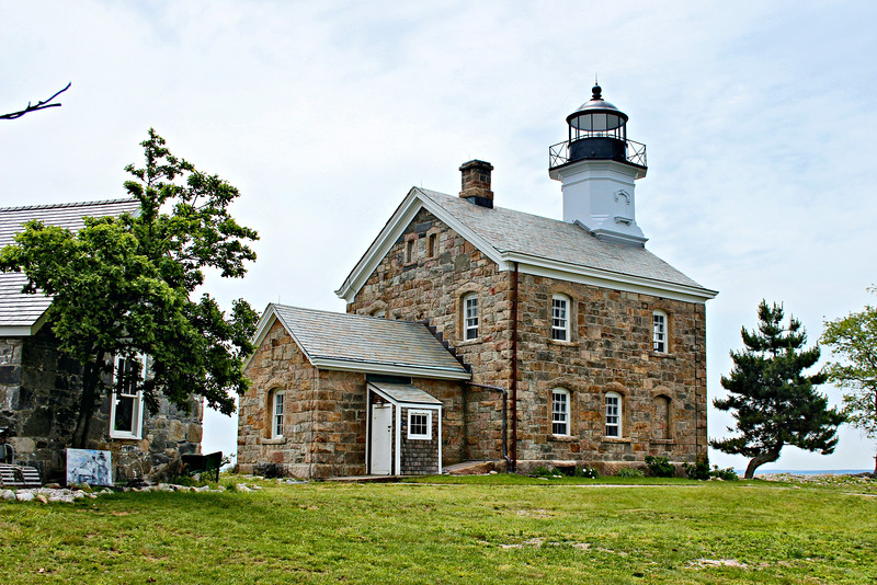 In March 1867 Congress appropriated $12,000 to rebuild the Sheffield Island Lighthouse.  A new 2½ story granite structure was completed in 1868.  A cast iron tower protruded from the front roof of the 10 room dwelling and rose to a height of forty-six feet.  The style is similar to other nearby lighthouses of the period built at Morgan Point, CT, Plum Island, NY and North Light on Block Island, RI.