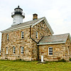The first Sheffield Island Lighthouse featured 10 rotating lamps with reflectors in its lantern.  The fronts of five of the lamps were fitted with red glass to produce an alternating white and red flash pattern.  The interval between flashes was originally 2 minutes and 45 seconds, however when ship captains complained about the length of the eclipse period, Gershom took it upon himself to reduce the period to 66 seconds.