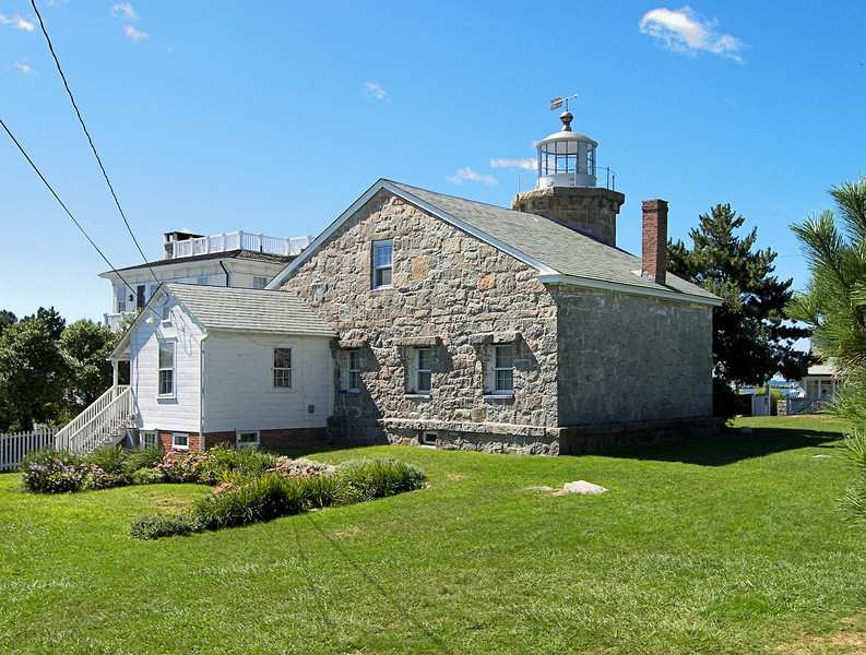 In 1840 John Bishop of New London, Connecticut was hired to construct the new lighthouse.  The old light was disassembled and the stones were used to build a new stone tower with an attached 1½ story Keepers dwelling.  The new structure was completed in September 1840.