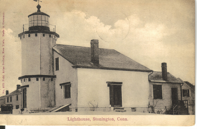 An old postcard showing the Stonington Harbor Lighthouse painted white.