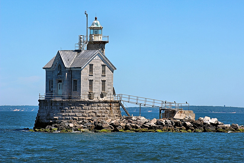 Once a foundation of granite pier blocks was completed in 1876, work began on the stone keepers dwelling and tower.  As work neared completion in November 1877 during a severe winter storm the schooner used to house the workers was driven onto the lighthouse rocks.  The men sought refuge in the lighthouse and watched the ship sink.