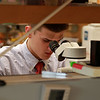 Leominster High School junior Connor Casey talks about doing experiments on C. elegans at UMass Medical School Aaron Lazare Research Building. Here Casey works in the lab on Tuesday, October 9, 2018 with the C. elegans. He was trying to move four C. elegans from one petri dish to another. This was so he could keep them alive. SENTINEL & ENTERPRISE/JOHN LOVE