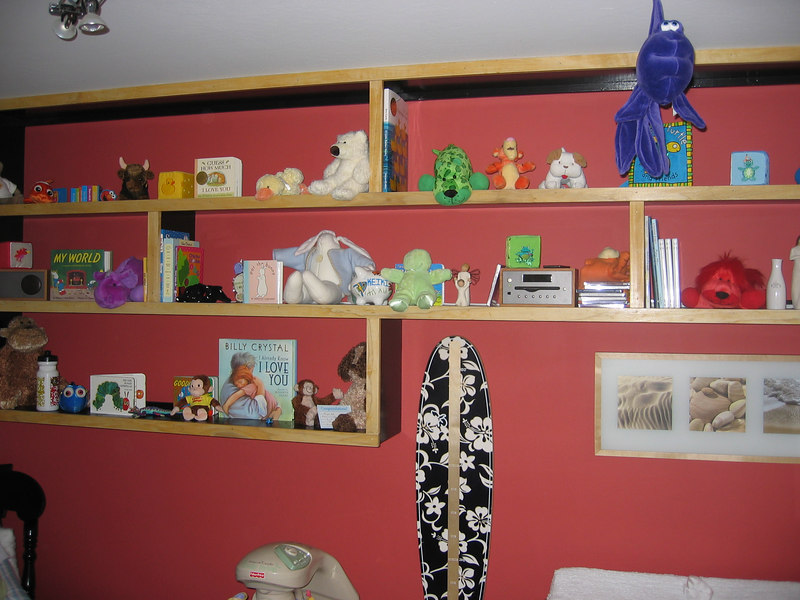 Connor's Nursery - Shelf full of animals and books.