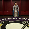 Penguins player and Cushing Academy alum Conor Sheary savors a quiet moment with the Stanley Cup in his old locker at Cushing before preparing to take photographs with fans. SENTINEL & ENTERPRISE / Ashley Green