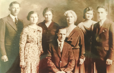 Conradi Family L to R: Willard, Margaret Ann, Eleanore, Myrtle (mother), Mildred, Gordon, in front, father William Christian Conradi. Date unknown.