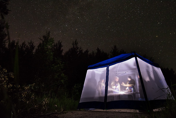 Biological data collection tent under the night sky
