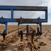 "A ""sand fighter"" implement is used to clod the soil to help prevent top soil from blowing away and to protect emerging cotton seedlings -- Lynn County, Texas."