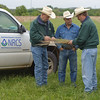 NRCS Texas range management specialists Kent Ferguson (right) and Lem Creswell (left) discuss ranch resource management goals with Montague County rancher Rooter Brite.