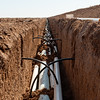 Blake Davis Farms in Lamb County near Littlefield, Texas, showing open ditches with black tubing tied into PVC pipe for a sub surface drip irrigation system.