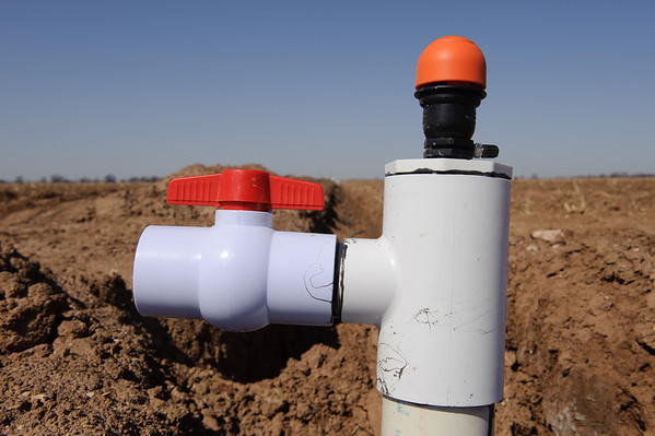Irrigation valve set for drip irrigation system being installed on Blake Davis Farms in Lamb County near Littlefield, Texas.