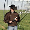 Landon Kerby, NRCS district conservationist spot checks new drop nozzles on a center pivot sprinkler system in Morton, Texas.