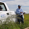 NRCS District Conservationist Calvin Devereaux completes status review on rotational grazing system with fencing, water storage facility and grass planting in Wheeler, Texas.