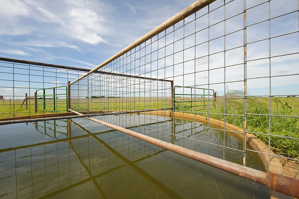 Water storage facility in rotational grazing system, Wheeler County near Wheeler, Texas.