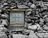 Colored Window in Stone Wall