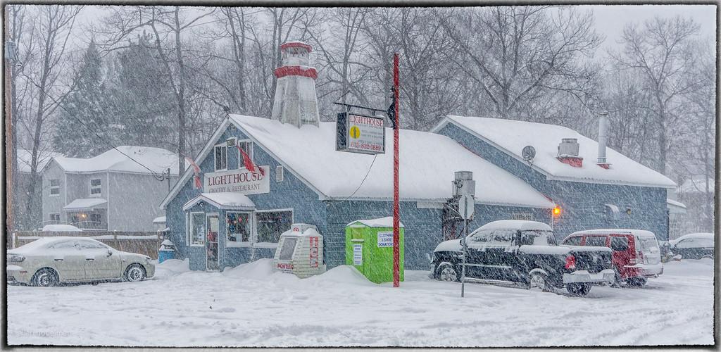 Lighthouse Restaurant During a Snowstorm