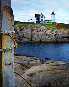 "Cape Neddick (""Nubble"") Light. I was there hoping to photograph the lighthouse in the sunset, but It was cloudy and getting more and more bleak every minute.  Since I couldn't get a spectacular sunlit image of one of the most photographed lighthouses in New England, I was forced to experiment with less traditional angles - hoping to get something more or less interesting..."