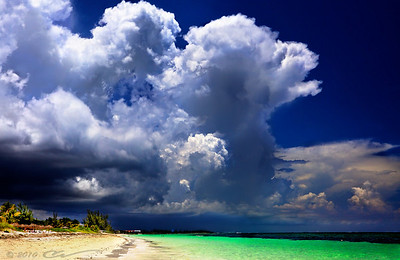 Storm clouds rapidly roll over the beach in Freeport, the Bahamas... The peaceful blue sky turned this dramatic and even scary almost suddenly - literally, within seconds.
