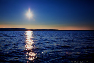 The sun is setting over the Antigonish Harbor in Nova Scotia, Canada.