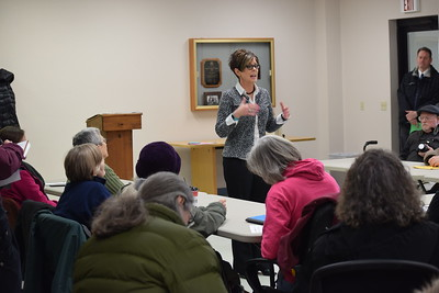 Karen Ruth, constituent relations representative for U.S. Rep. John Moolenaar (R-Midland) addresses a crowd of 75 during a meeting Monday, Jan. 30 at the Coe Township Hall in Shepherd.
