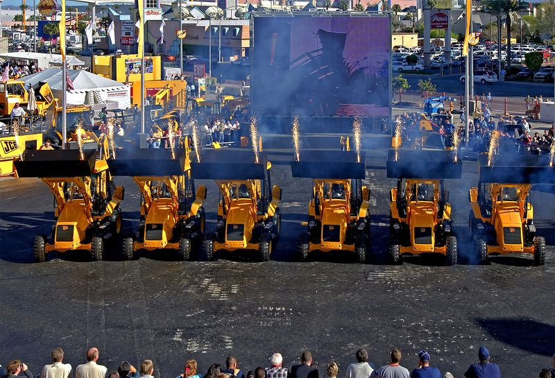 Earthmoving construction: First day of CONEXPO 2005. JCB Dancers finale, with JCB backhoe-loader excavators lighting up every hour. Las Vegas, Nevada, March 15, 2005.
