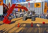 Earthmoving construction: First day of CONEXPO 2005. Link-Belt rodeo with backhoe excavator, all operators welcome. Pick basketball off each cone, without disturbing cone, and drop it in the bucket. Record is 28 seconds. Las Vegas, Nevada, March 15, 2005.
