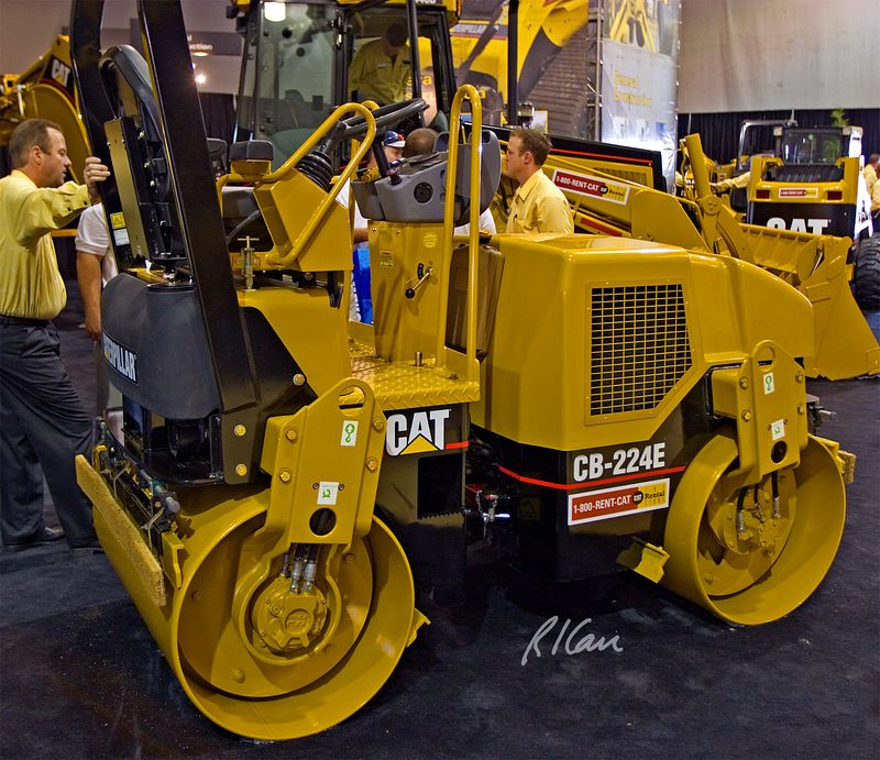 Compaction construction equipment: First day of CONEXPO 2005. Discussing the Caterpillar CB-224E roller. Las Vegas, Nevada, March 15, 2005.