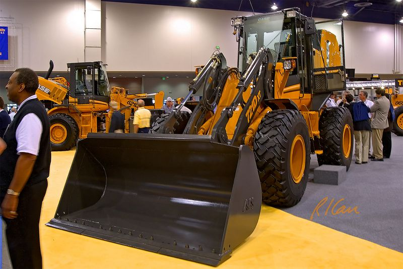 Earthmoving construction: Case 721D XT wheel loader, 127 kw/ 170 hp, 2.3 m3/ 3 CY, 6,300 kg/ 14,000 lb. CONEXPO, Las Vegas, Nevada, March 15, 2005.