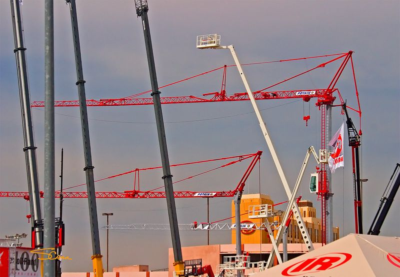 Elevated and vertical construction: Gold Lot exhibits of hydraulic cranes, cable cranes, tower cranes, and personnel lift. Photo by Scott Carr. CONEXPO, Las Vegas, Nevada, March 15-19<br /> , 2005.