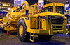 Earthmoving construction: Caterpillar 627G 330 hp / 246 KW 22 yd3 / 17m3 (heaped), 15.7 yd3 / 12 m3 (struck), 84,000 lb / 38,000 kg, 42 ft / 13 m length self-loading scraper. CONEXPO, Las Vegas, Nevada, March 15-19, 2005.