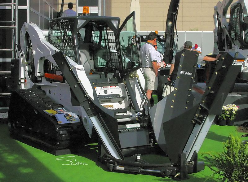 Landscape construction: Bobcat track tractor with tree spader that can dig and transplant or package without operator leaving the seat. CONEXPO 2005, Las Vegas, Nevada, March 15-19, 2005