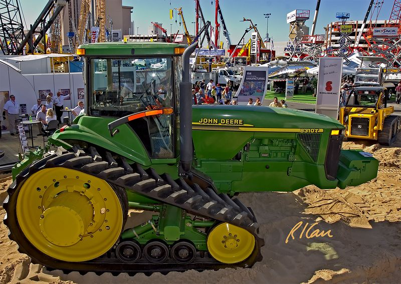 Earthmoving construction: Solideal rubber tracks on John Deere 8310T tractor. CONEXPO, Las Vegas, Nevada, March 15-19, 2005.