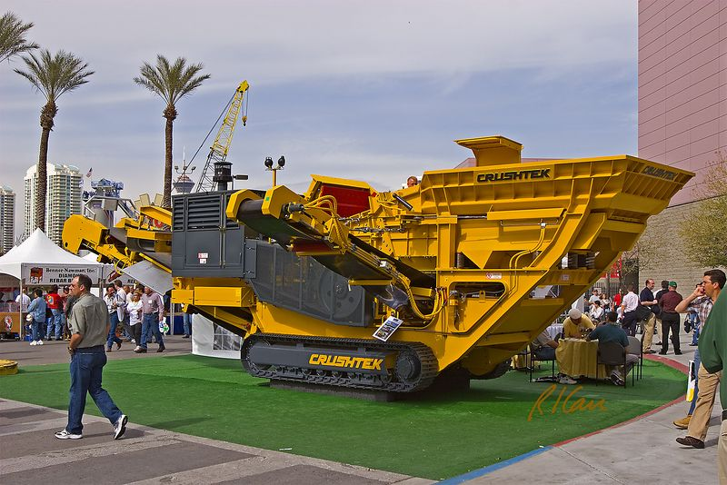 Concrete, asphalt, aggregate construction: Mobile Constructek, tracked, stone crusher with extended conveyors for product and waste. CONEXPO, Las Vegas, Nevada, March 15-19, 2005.