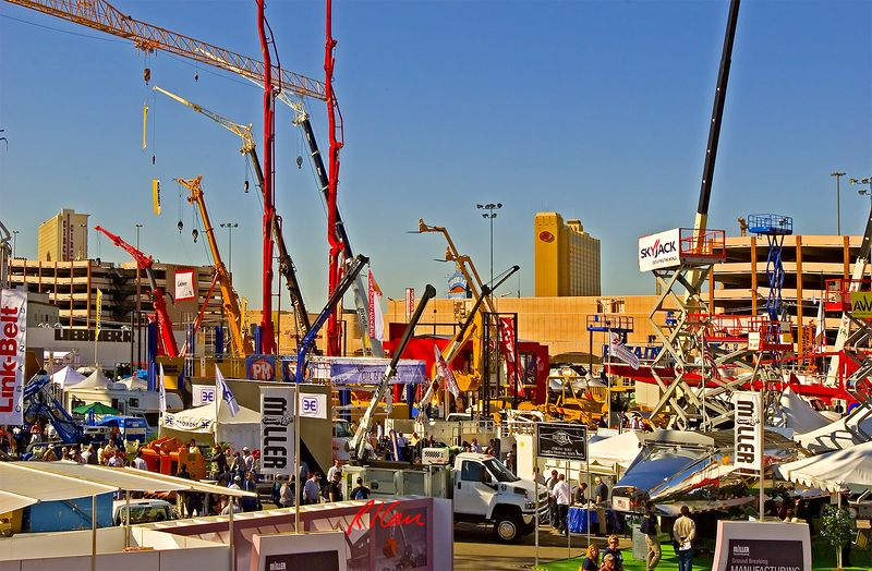 Elevated and vertical construction: First day of CONEXPO 2005, Gold Lot exhibits of hydraulic cranes, cable cranes, tower cranes, personnel lifts, high forkifts, tractors, and earthmoving construction equipment. Las Vegas, Nevada, March 15, 2005.