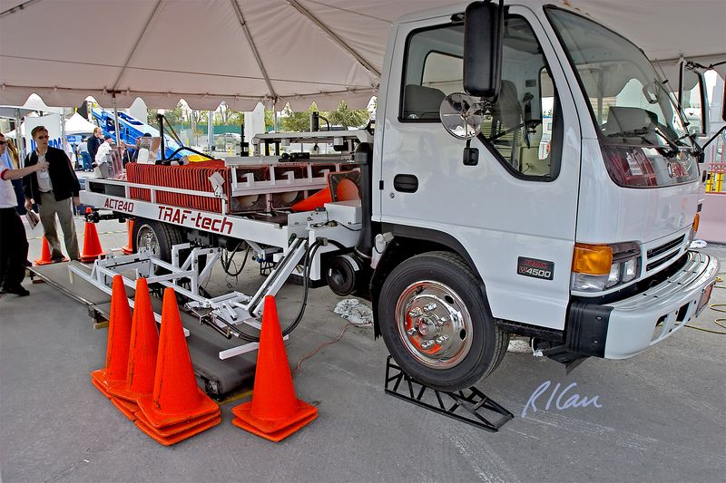 CONEXPO 2005, road construction safety: Traf-Tech CT240 traffic cone automated placement and retrieval truck. It operates on either side, as truck moves along. CONEXPO Silver Lot, Las Vegas, Nevada, March 15-19, 2005.