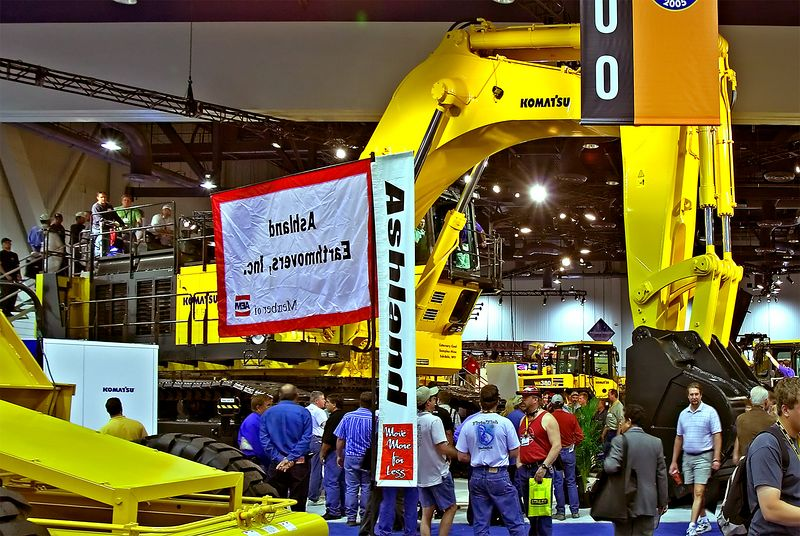 Earthmoving construction: Komatsu PC1800 giant mining/ construction track mounted backhoe excavator dominates the floor. It features a 15.7 yd3 buck and 2 Komatsu Saa6D140E-2 engines generating a compound output of 908 hp. CONEXPO, Las Vegas, Nevada, March 15-19, 2005.
