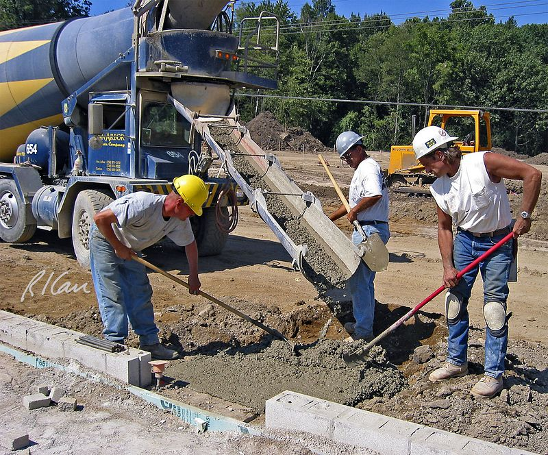 Placing concrete footing at grade from ready-mix truck chute. Huron Village Shopping Center, Ann Arbor, 2002.