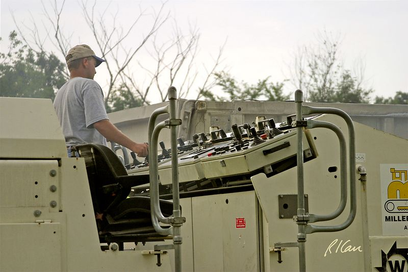Operator at controls of Wirtgen W2000 asphalt cold milling machine. Huron Parkway, 2003, Ann Arbor